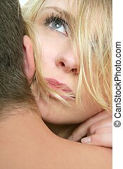 Beautiful blond woman portrait, hug with a man, close up