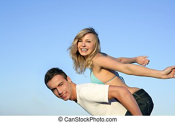 beautiful young couple playing together