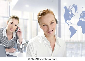 Modern office, two beautiful businesswoman, helpdesk,...