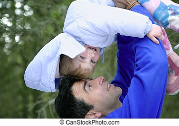 Father winter upside down daughter outdoors - Father winter...