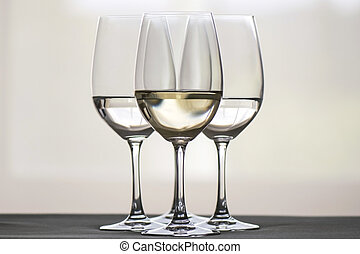 glasses of wine - Four glasses of white wine, arranged...