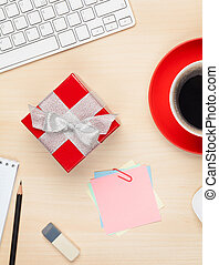 Red gift box on office table View from above