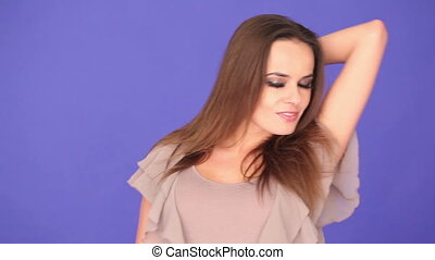 pretty woman smiling on purple background