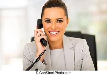 businesswoman talking on phone - close up portrait of cute...
