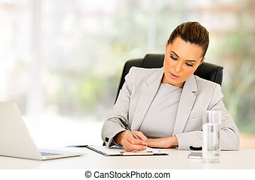 busy businesswoman working in office