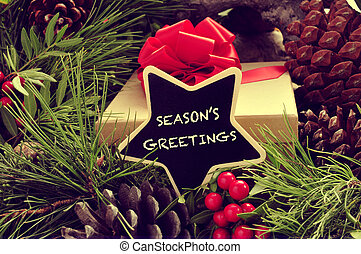 seasons greetings - a star-shaped signboard with the text...