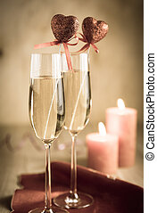 Glasses of champagne in candlelit on St Valentines day