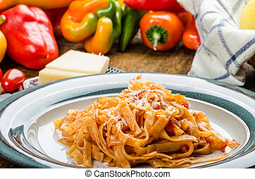 Pasta arrabiata with peppers from bio garden