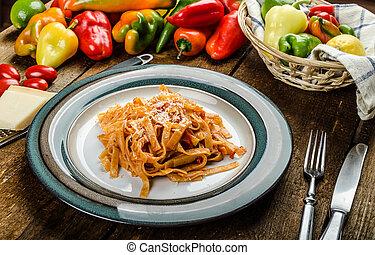 Pasta arrabiata with peppers from bio garden