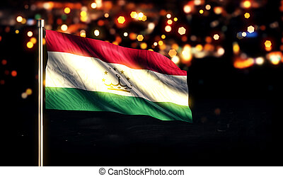 Tajikistan National Flag City Light Night Bokeh Background...