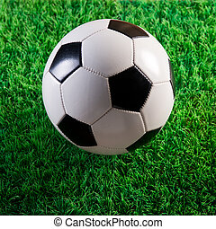 Soccer ball on artificial turf
