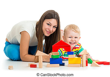 kid boy playing toys together mother