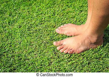 Foot step on green grass