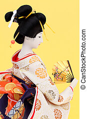 Traditional Japanese geisha doll side view