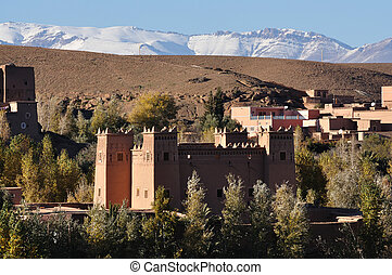 Moroccan casbah, Atlas mountains in the background