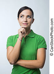 Smiling woman thinking with hand on chin - Smiling...