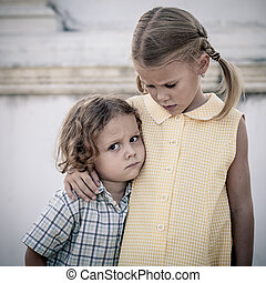Portrait of sad little girl and boy at the day time