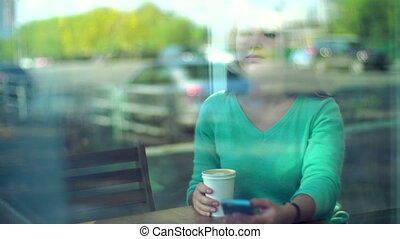 Morning Coffee - Through the window shot of attractive girl...