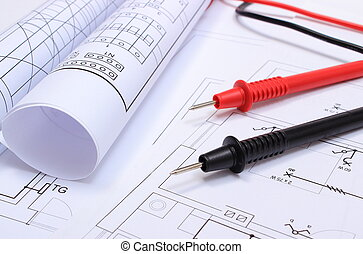 Rolled electrical diagrams and cables of multimeter on...