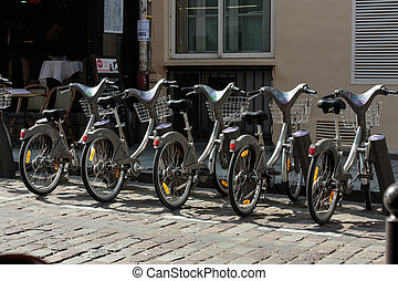 Parking of bicycles for rent on the streets of Paris