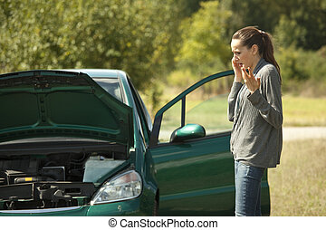 Car Breakdown - car breakdown on the road, woman calling for...