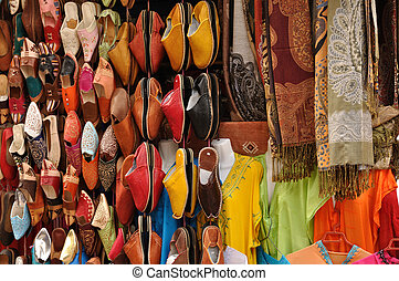 Colorful shoes and clothes for sale in Essaouria, Morocco