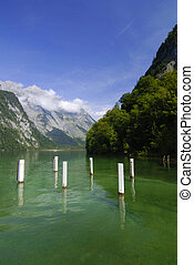 Mountain lake - Famous lake Konigssee with boat pier and...