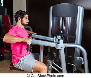 Seated back row machine man workout at gym - Seated back row...