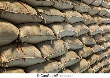 Rice bags - Rice grain sacks in warehouse