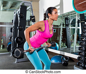 Barbell bent over row supine grip woman workout at gym...