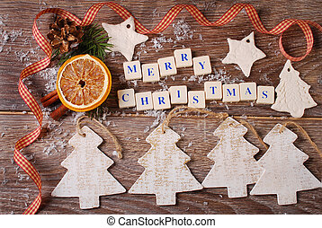 merry christmas greeting card on wooden background -...