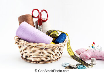 Sewing utensils, scissors, thread, buttons isolated on white...