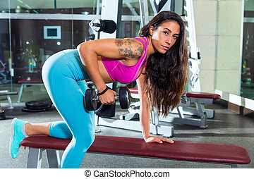dumbbell triceps kickback girl exercise at gym - dumbbell...