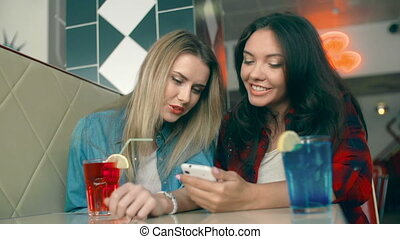 Young and Free - Two girls making selfie in bar