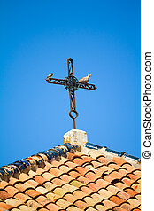 Old rusty cross - Roof with old forged iron cross and two...