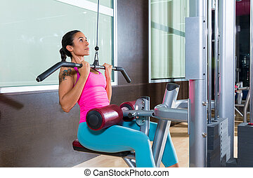 Lat pulldown machine woman workout at gym - Cable Lat...