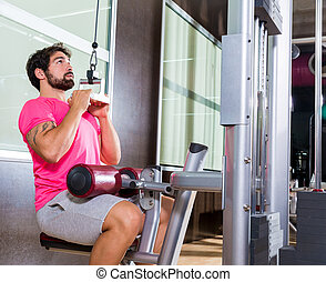Cable Lat pulldown machine man workout at gym exercise