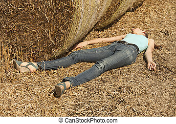 woman unconscious in field - young woman lying dead in the...