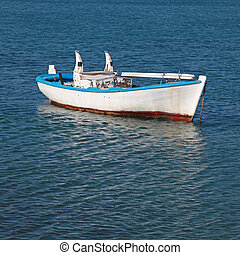 old wood boat at a Mediterranean sea(Greece) - Blue and...