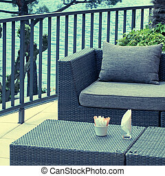 Al fresco cafe with rattan furniture on the terrace, Lake...