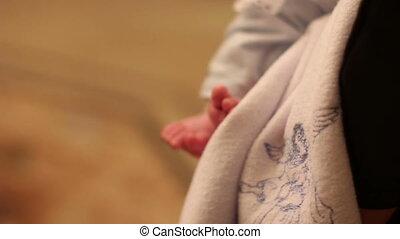 christening. feet newborn in chirch close-up