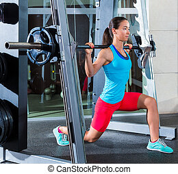 girl squats in multipower squatting smith machine barbell at...