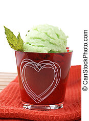Delicious mint ice cream in red glass bowl. Shallow depth of...