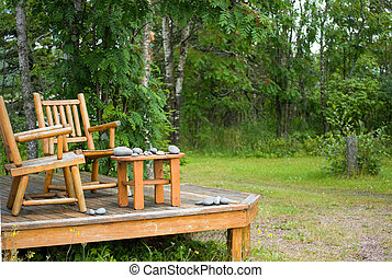 lake superior porch - two pine log chairs on porch with...