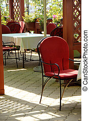 Outdoor cafe - summer patio cafe restaurant chairs and...