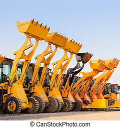 The row of heavy construction excavator machine against blue...