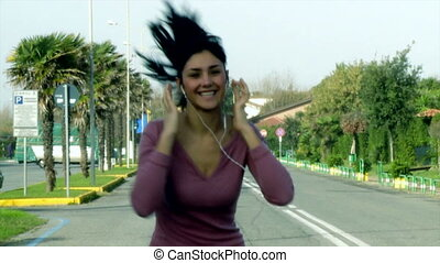 woman running on street slow motion