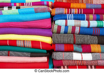 Collection of colourful woolen scarfs