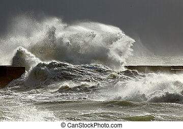 Stormy waves against pier with interesting light - Big...