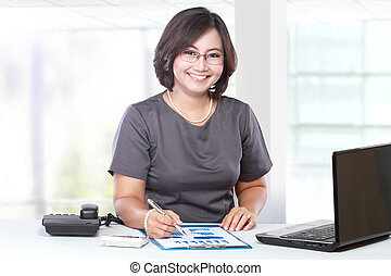 business woman working in the office - business woman...